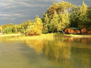 sunset on the lake shore reflecting off the Pineridge Resort Cabin